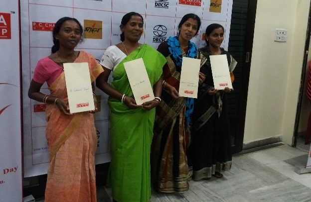 Women achievers with their awards