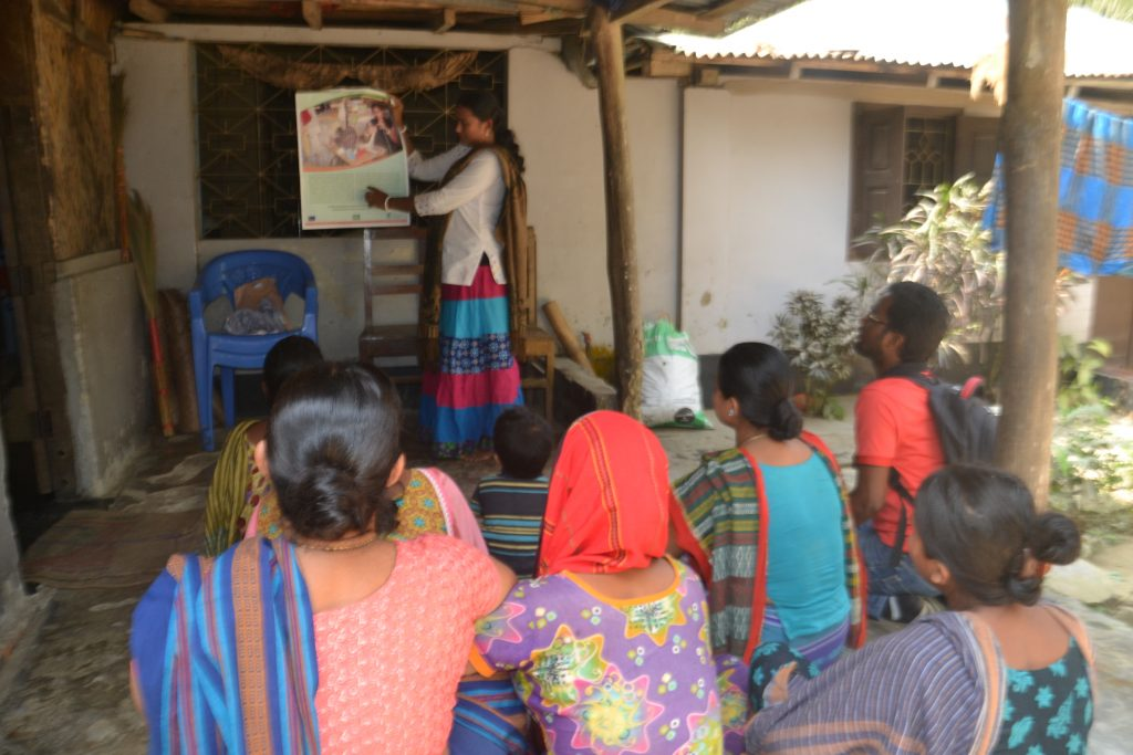 Suporna counselling women in her village